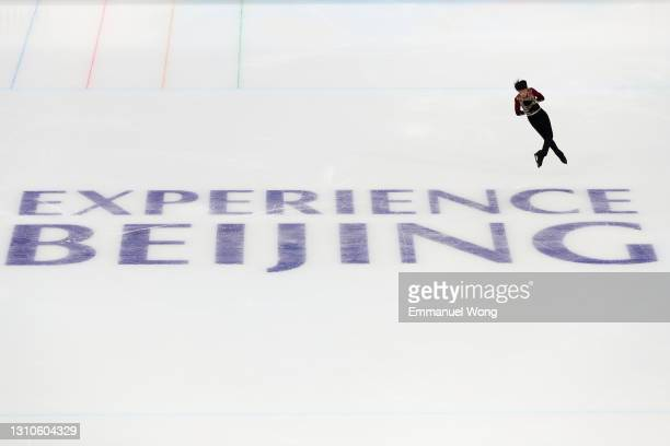Tang Hanping of China competes during the men's single skating test event for the 2022 Beijing Winter Olympic Games at the Capital Indoor Stadium on...