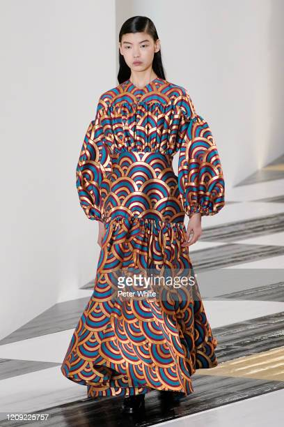 Tang He walks the runway during the Loewe show as part of the Paris Fashion Week Womenswear Fall/Winter 2020/2021 on February 28, 2020 in Paris,...