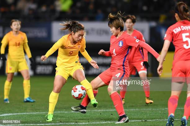 Tang Jiali of China and Shin Damyeong of South Korea compete for the ball during the EAFF E1 Women's Football Championship between South Korea and...