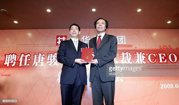 Tang Jun former President of Shanda Interactive Entertainment Ltd receives the appointment certificate from Chen Fashu Chairman Xinhuadu Industrial...