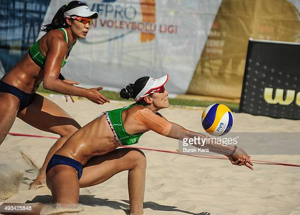 Tang NY of China receives the ball during the 1st day of the FIVB Antalya Open beach volley tournament October 20 in the Mediterranian resorty city...