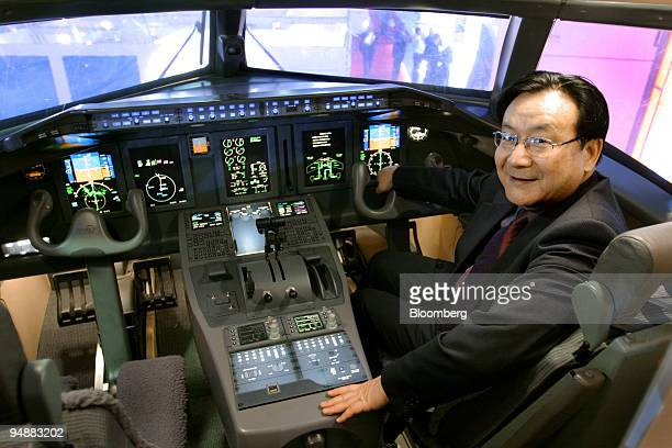 Tang Xiaoping general manager for commercial aircraft at China Aviation Industry Corp I poses in a mockup of the company's ARJ21 regional passenger...