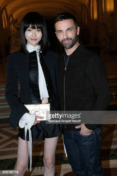 Tang Yan and Stylist Nicolas Ghesquiere pose after the Louis Vuitton show as part of the Paris Fashion Week Womenswear Fall/Winter 2018/2019 on March...