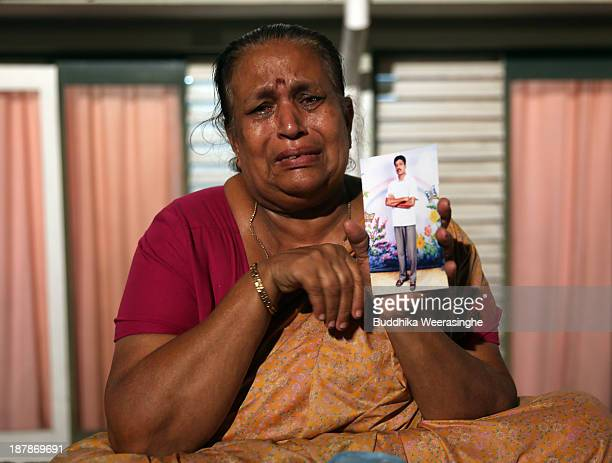 Tangaraja Rajeshwari a woman belonging to the Sri Lankan minority Tamil ethnic group holds up a photo of her son who disappeared during the final...
