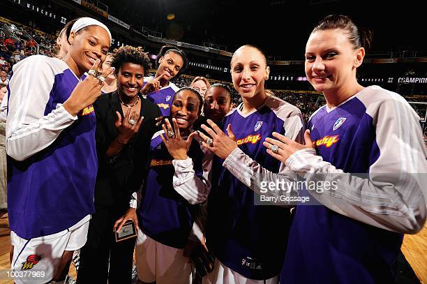 Tangela Smith assistant coach Bridget Pettis Temeka Johnson Diana Taurasi and Penny Taylor of the Phoenix Mercury show off their WNBA Championship...