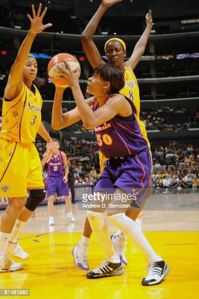 Tangela Smith of the Phoenix Mercury is surrounded by Candace Parker and DeLisha MiltonJones of the Los Angeles Sparks on June 6 2008 at Staples...