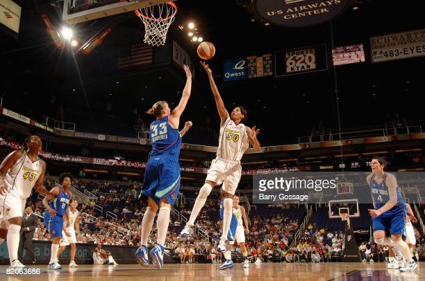 Tangela Smith of the Phoenix Mercury puts a shot up over Cathrine Kraayeveld of the New York Liberty during the WNBA game on July 5 2008 at US...