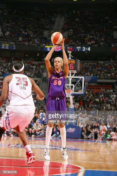 Tangela Smith of the Phoenix Mercury shoots a jump shot against Cheryl Ford of the Detroit Shock during Game Five of the WNBA Finals at The Palace of...