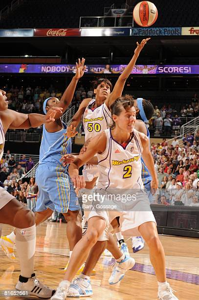 Tangela Smith of the Phoenix Mercury shoots against Tye'sha Fluker of the Chicago Sky on June 20 at U.S. Airways Center in Phoenix, Arizona. NOTE TO...