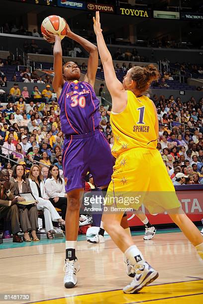 Tangela Smith of the Phoenix Mercury shoots over Christi Thomas of the Los Angeles Sparks on June 6 2008 at Staples Center in Los Angeles California...