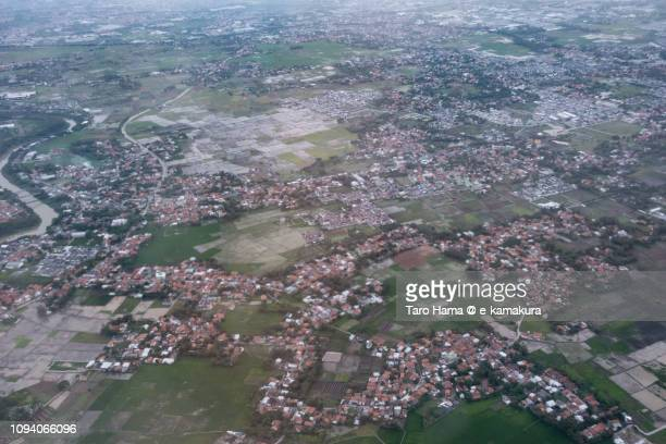 Tangerang city in Banten in Indonesia sunset time aerial view from airplane
