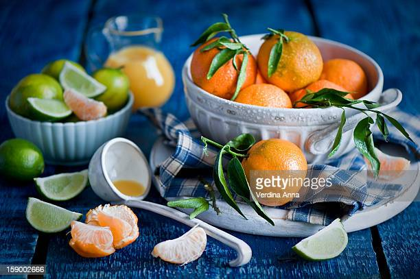 tangerines for breakfast: fresh and juicy - anna verdina stock photos and pictures