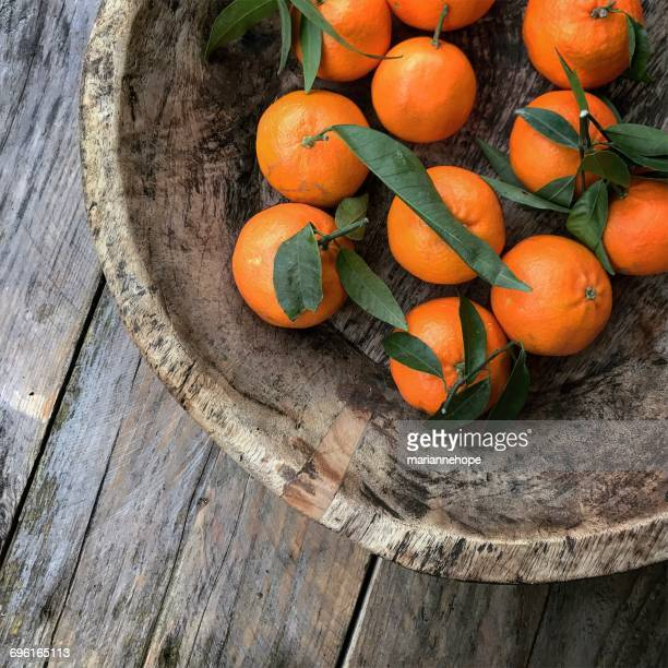 Tangerines in a wooden bowl