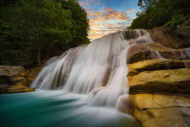 Tanggedu Waterfall at sunset, Tanggedu, Kanatang, East Sumba, East Nusa Tenggara, Indonesia