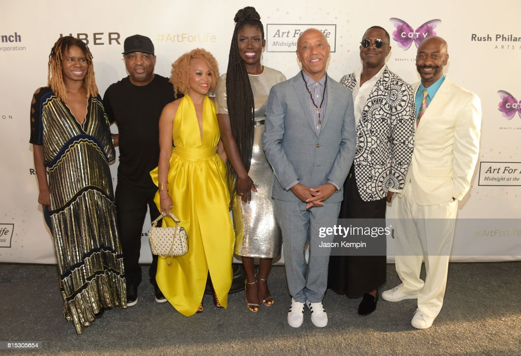 Tangie Murray, Chuck D, Esi Eggleston Bracey, Bozoma Saint John, Russell Simmons; Sanford Biggers, Stephen G. Hill pose for a photo during 'Midnight At The Oasis' Annual Art For Life Benefit hosted by Russell Simmons' Rush Philanthropic Arts Foundation at Fairview Farms on July 15, 2017 in Water Mill, New York.