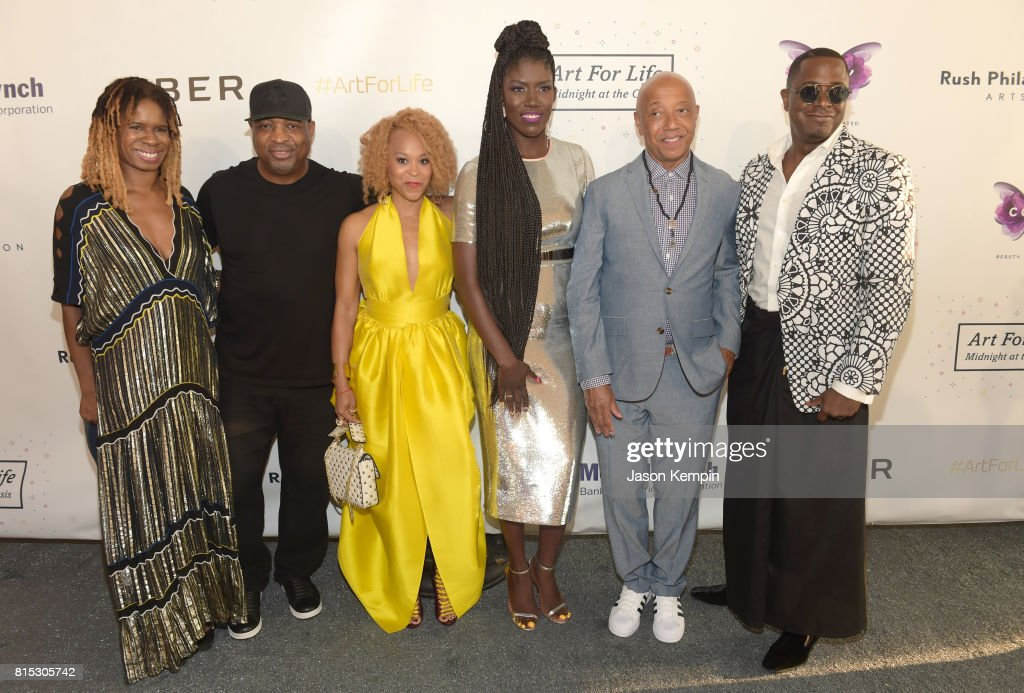Tangie Murray, Chuck D, Esi Eggleston Bracey, Bozoma Saint John, Russell Simmons; Sanford Biggers pose for a photo during 'Midnight At The Oasis' Annual Art For Life Benefit hosted by Russell Simmons' Rush Philanthropic Arts Foundation at Fairview Farms on July 15, 2017 in Water Mill, New York.