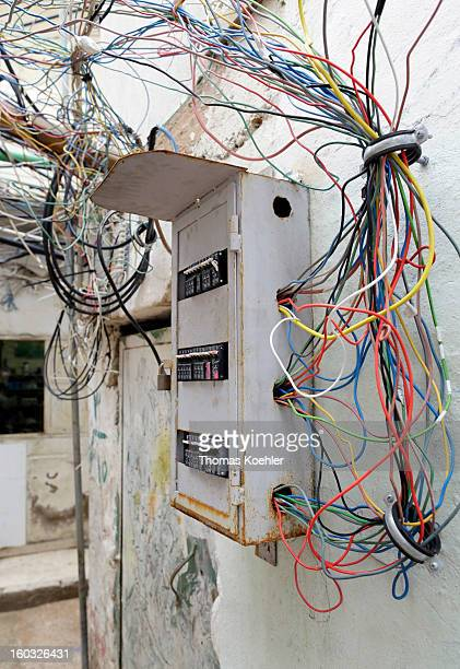A tangle of electric cables and a fuse box in the Palestinian Refugee Camp Burj Barajneh the likes of which causes many fatal electrocution accidents...