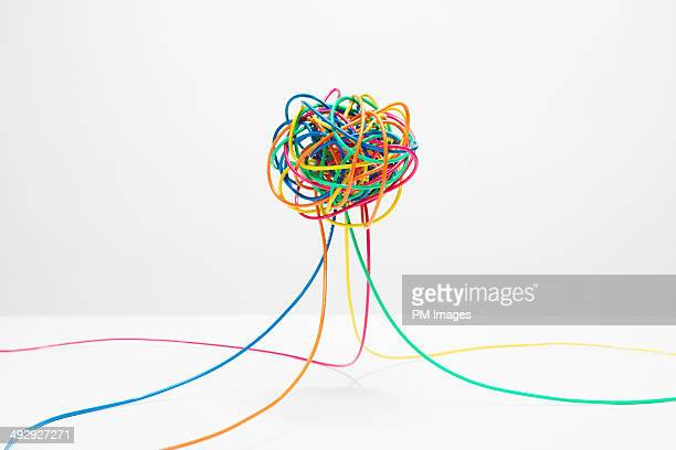 tangle of multi colored wire - comunicazione foto e immagini stock