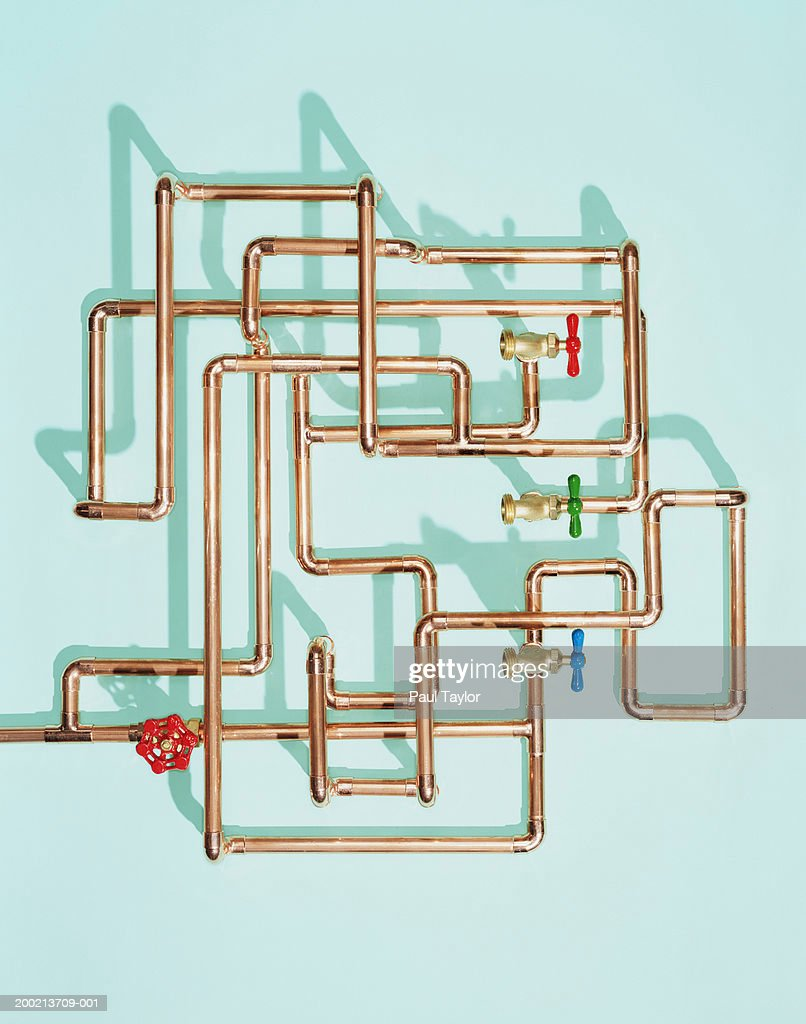 Tangle of water pipes and taps : Stock Photo