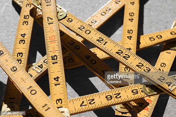 tangled folding ruler, close-up - inch stock pictures, royalty-free photos & images