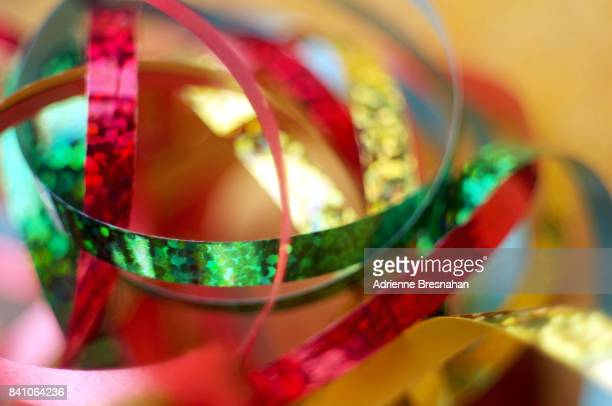 tangled swirl of holographic ribbons - embellishment stock pictures, royalty-free photos & images