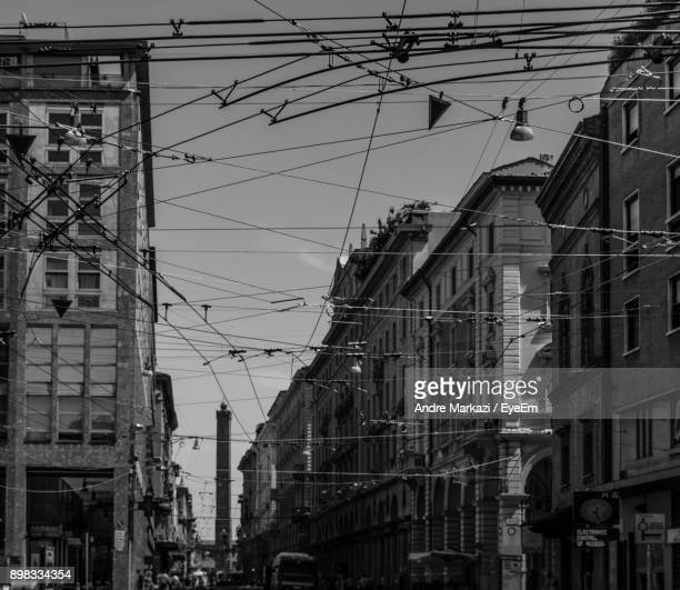 Tangled Wire Amidst Buildings Against Sky