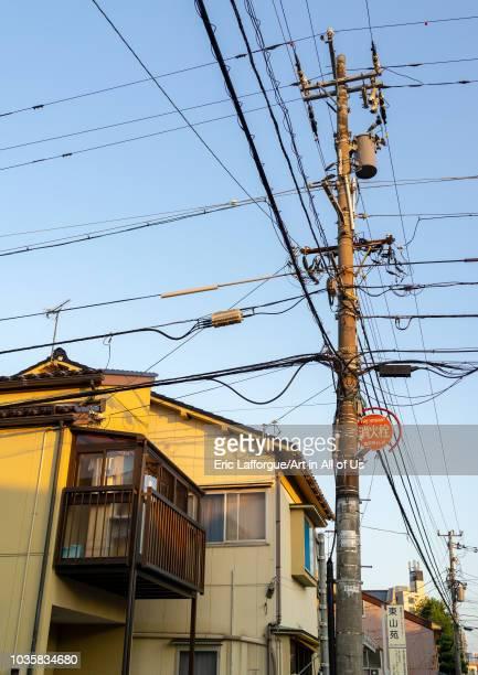 Tangled wires on electric pole in Kazue-machi chaya geisha district, Ishikawa Prefecture, Kanazawa, Japan on August 5, 2018 in Kanazawa, Japan.