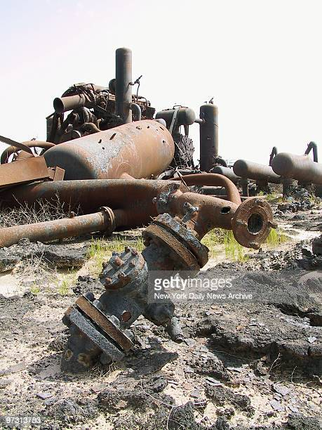 Tangled wreckage remains at an oil field in the Burgan region of southern Kuwait. The oil fields were destroyed by retreating Iraqi troops during the...