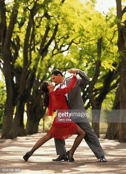 Tango couple dancing in park, Buenos Aires, Argentina