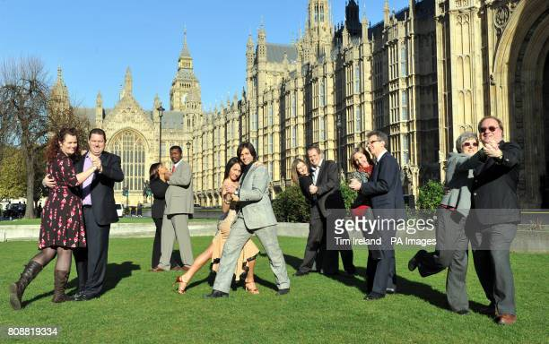 Tango dancer KerriAnne Donaldson and Italian Opera star Gianluca Paganelli show couples how to salsa on College Green in London to promote marriage...