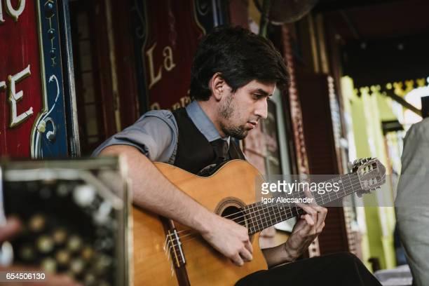 tango guitarist, caminito, la boca, buenos aires, argentina - argentina traditional clothing stock photos and pictures
