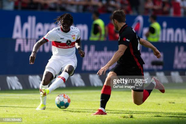 Tanguy Coulibaly of VfB Stuttgart and Christopher Lenz of Eintracht Frankfurt battle for the ball during the Bundesliga match between Eintracht...