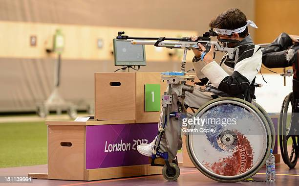 Tanguy De La Forest of France competes in the Mixed R410m Air Rifle Standing Shooting SH2 final on day 4 of the London 2012 Paralympic Games at The...