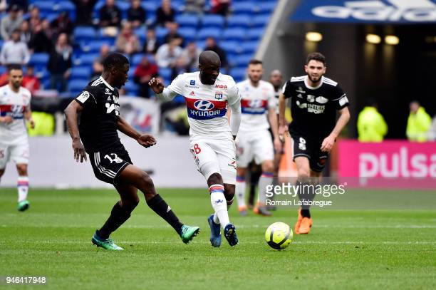 Tanguy Ndombele Alvaro of Lyon and Bakaye Dibassy of Amiens during the Ligue 1 match between Lyon and Amiens at Parc Olympique on April 14 2018 in...