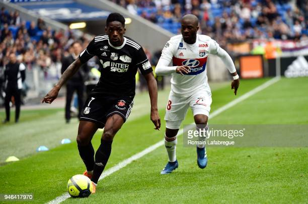 Tanguy Ndombele Alvaro of Lyon and Harrison Manzala of Amiens during the Ligue 1 match between Lyon and Amiens at Parc Olympique on April 14 2018 in...