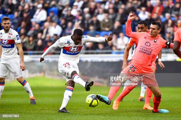 Tanguy Ndombele Alvaro of Lyon and Julien Feret of Caen during the Ligue 1 match between Olympique Lyonnais and SM Caen at Parc Olympique on March 11...