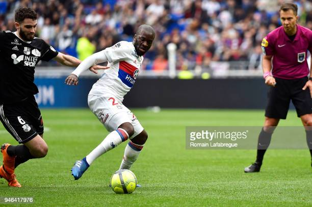 Tanguy Ndombele Alvaro of Lyon and Thomas Monconduit of Amiens during the Ligue 1 match between Lyon and Amiens at Parc Olympique on April 14 2018 in...