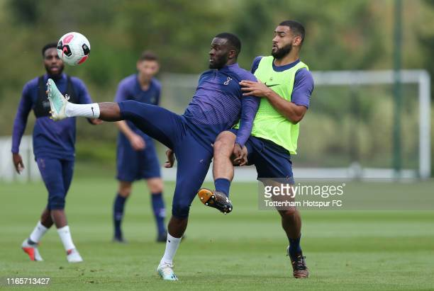 Tanguy Ndombele and Cameron Carter Vickers of Tottenham Hotspur during the Tottenham Hotspur training session at Tottenham Hotspur Training Centre on...