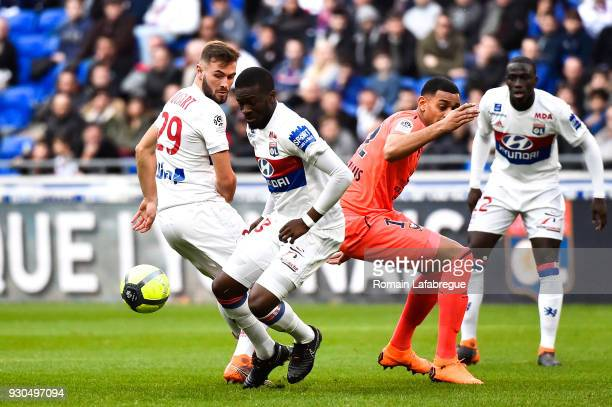 Tanguy Ndombele and Lucas Tousart of Lyon during the Ligue 1 match between Olympique Lyonnais and SM Caen at Parc Olympique on March 11 2018 in Lyon