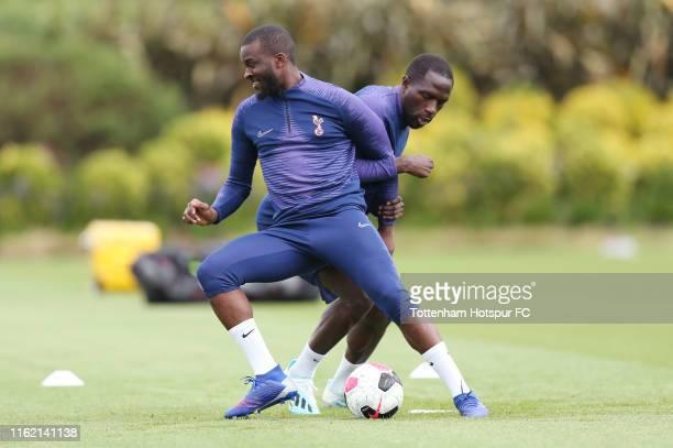 Tanguy Ndombele and Moussa Sissoko of Tottenham Hotspur during the Tottenham Hotspur training session at Tottenham Hotspur Training Centre on July 15...