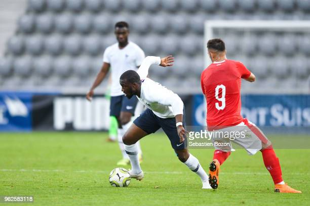 Tanguy Ndombele of France and Albian Ajeti of Switzerland during the Friendly match between Switzerland and France on May 25 2018 in Biel Switzerland
