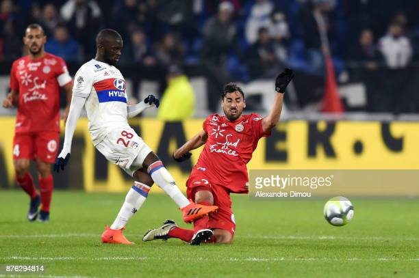 Tanguy Ndombele of Lyon and Facundo Piriz of Montpellier during the Ligue 1 match between Olympique Lyonnais and Montpellier Herault SC at Parc...