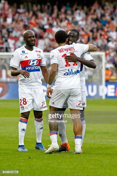 Tanguy Ndombele of Lyon and Ferland Mendy of Lyon and Memphis Depay of Lyon celebrates scoring his goal during the Ligue 1 match between Metz and...