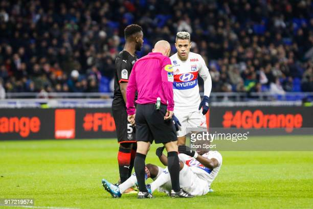 Tanguy Ndombele of Lyon and Mariano Diaz of Lyon and Referee Amaury Delerue during the Ligue 1 match between Olympique Lyonnais and Stade Rennes at...