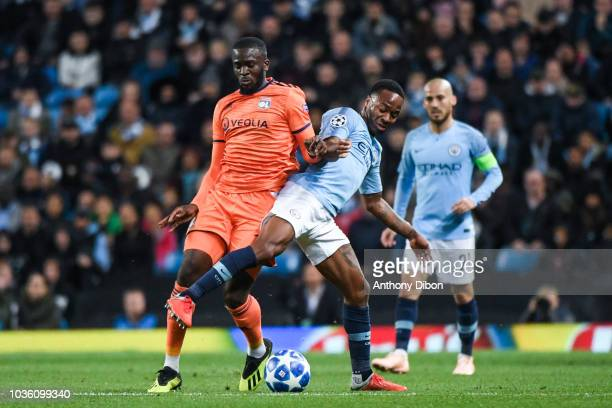 Tanguy Ndombele of Lyon and Raheem Sterling of Manchester City during the Champions League match between Manchester City and Lyon at Etihad Stadium...