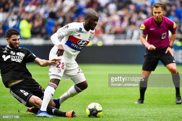 Tanguy Ndombele of Lyon and Thomas Monconduit of Amiens during the Ligue 1 match between Lyon and Amiens at Parc Olympique on April 14 2018 in Lyon