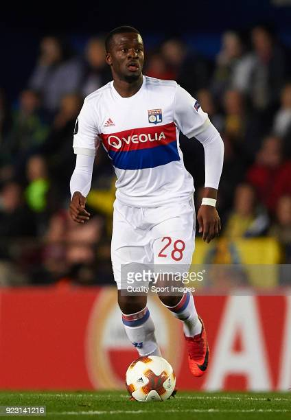 Tanguy Ndombele of Olympique Lyon runs with the ball during UEFA Europa League Round of 32 match between Villarreal and Olympique Lyon at the Estadio...