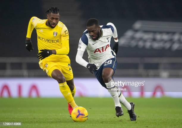 Tanguy Ndombele of Tottenham Hotspur and André-Frank Zambo Anguissa of Fulham during the Premier League match between Tottenham Hotspur and Fulham at...