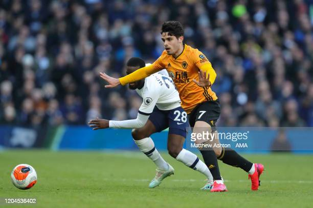Tanguy Ndombele of Tottenham Hotspur and Pedro Neto of Wolverhampton Wanderers during the Premier League match between Tottenham Hotspur and...