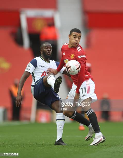 Tanguy NDombele of Tottenham Hotspur battles for possession with Mason Greenwood of Manchester United during the Premier League match between...